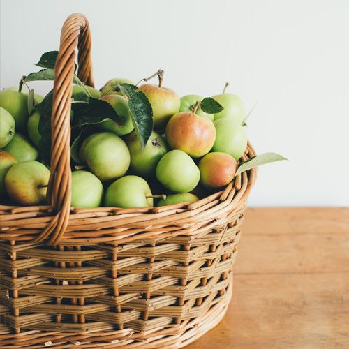 Basket filled with green apples