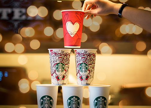 Starbucks cups stacked on top of each other